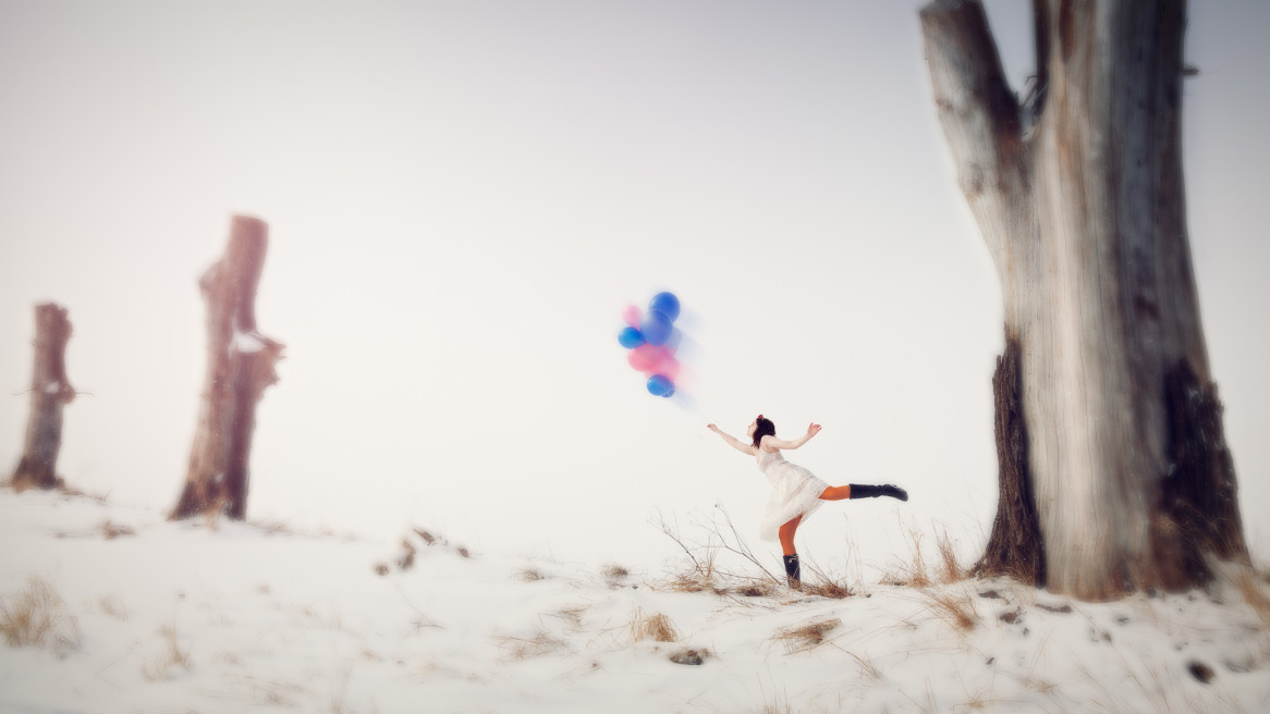 Model: Sarah. Wintery fashion, dreamy balloons and surreal miniature rural Swedish landscape
